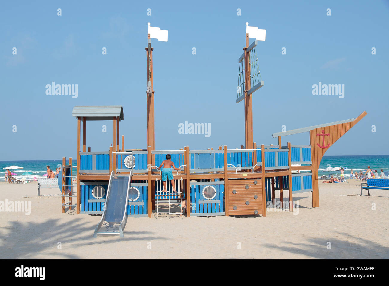 beach landscape with a boat shaped toboggan - Stock Image