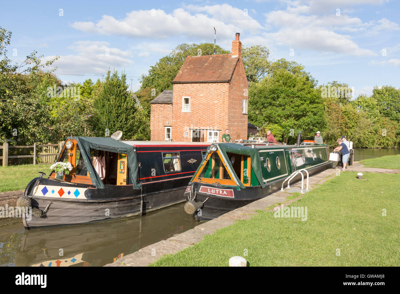 Narrowboats in lock 2 at Braunston on the the Grand Union Canal, Northamptonshire, England, UK - Stock Image