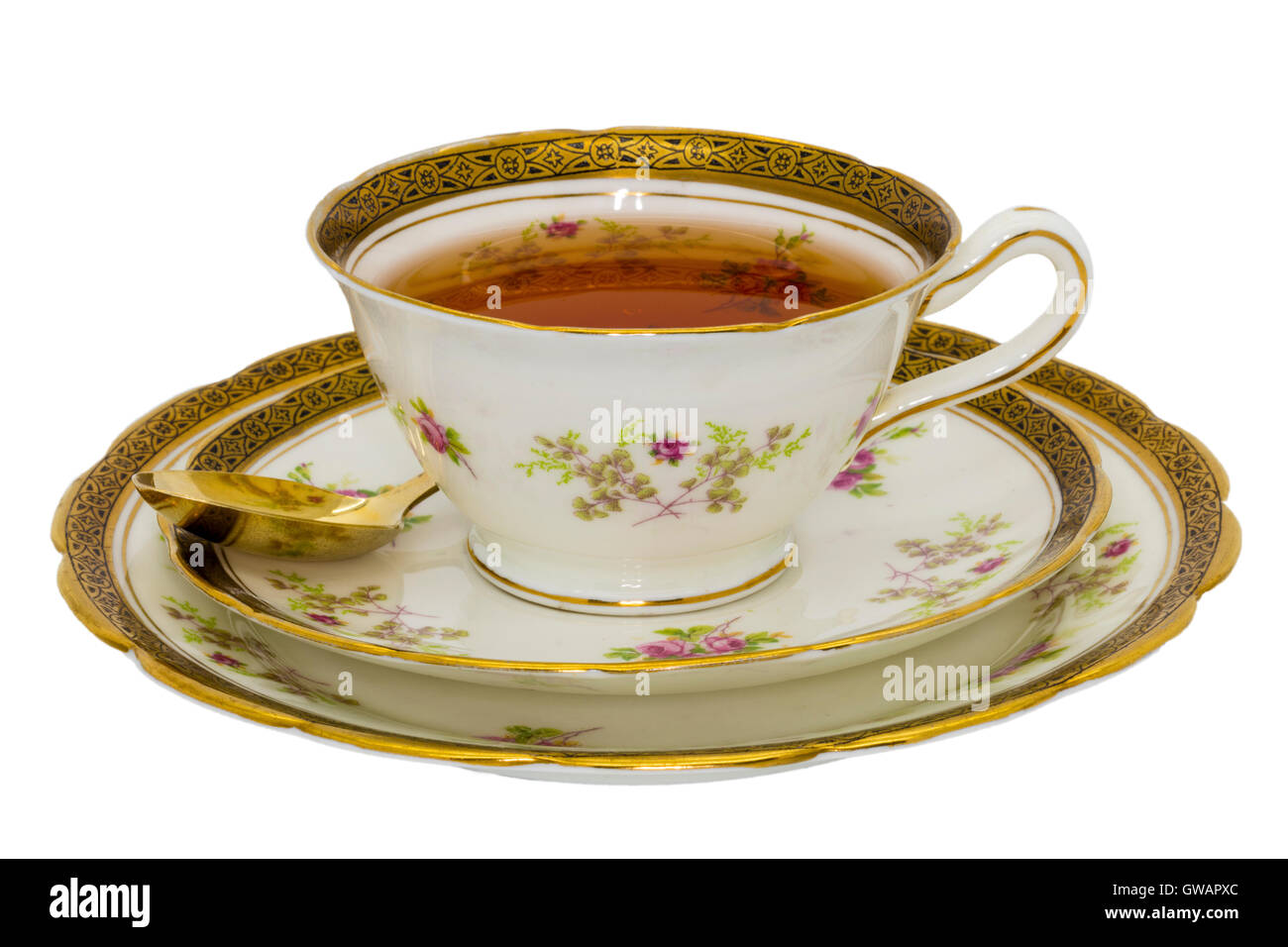 Tea in an antique fine china cup. - Stock Image