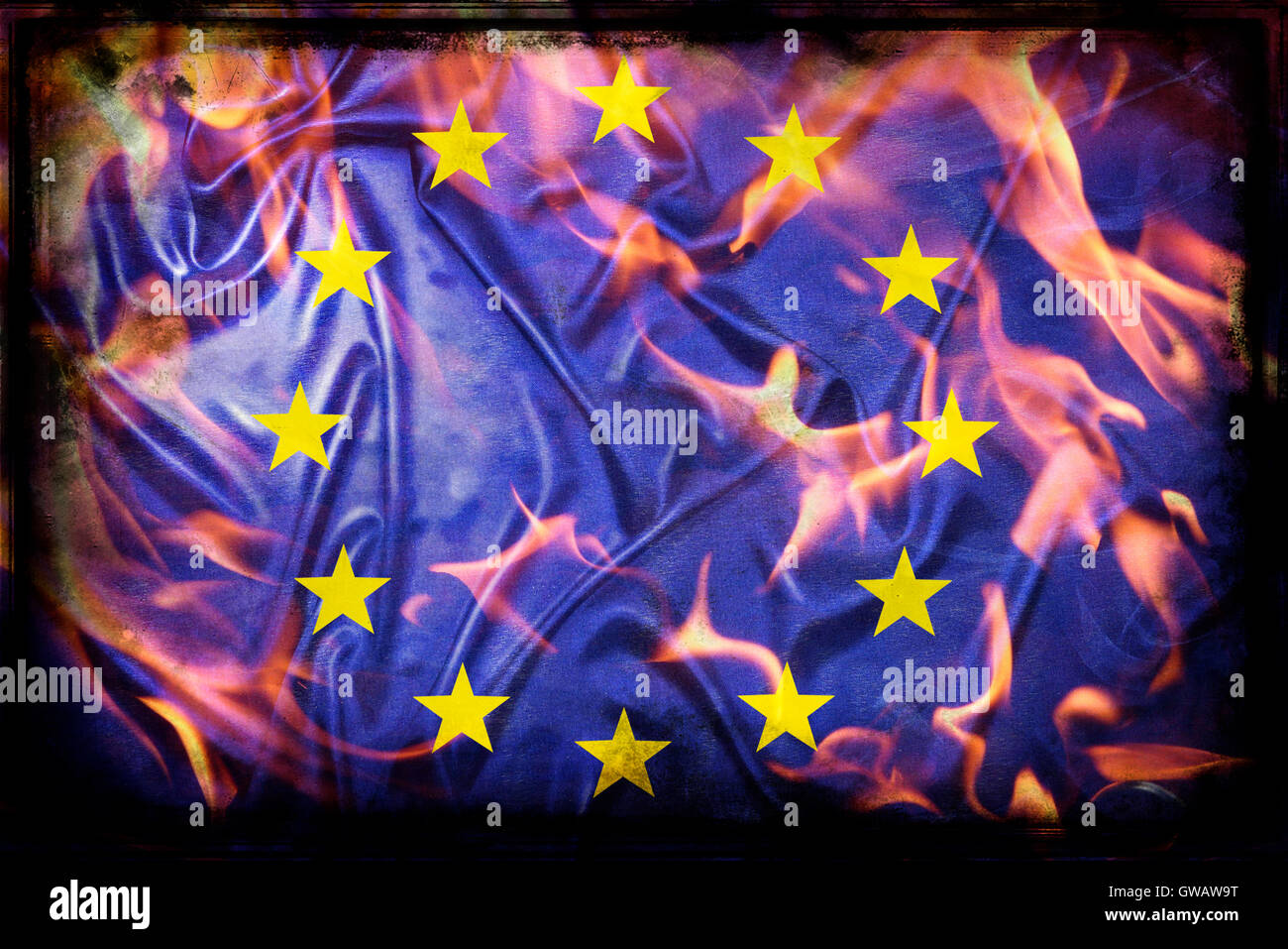 European flag in flames, symbolic photo Europe after the Brexit vote, Europa-Fahne in Flammen, Symbolfoto Europa - Stock Image