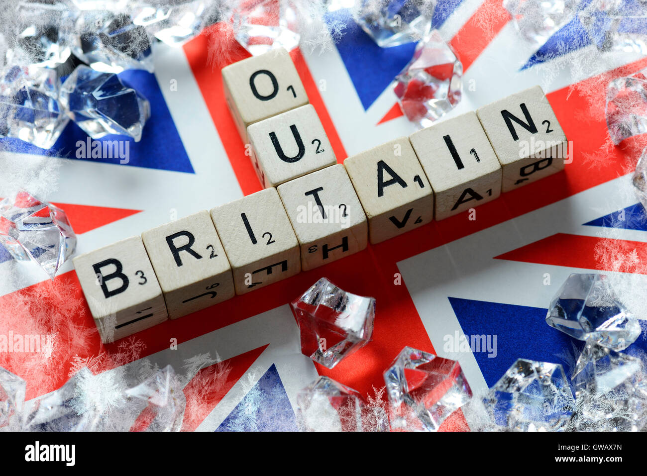 Letter cubes form the concepts Britain and Out on flag of Great Britain, symbolic photo Brexit, Buchstabenwuerfel - Stock Image