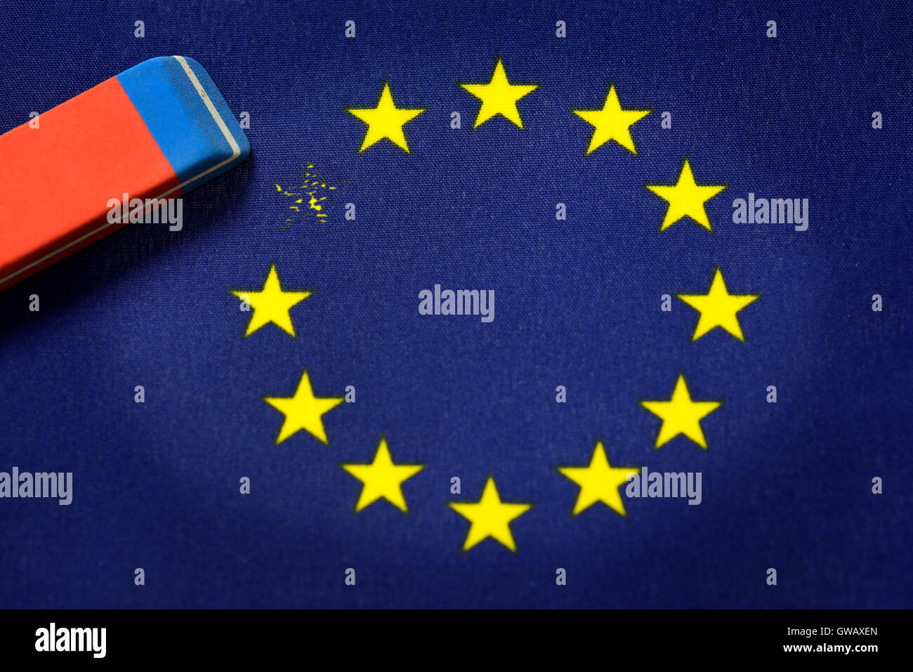 From EU flag star is erased out, symbolic photo Brexit, Aus EU-Fahne wird Stern ausradiert, Symbolfoto Brexit Stock Photo