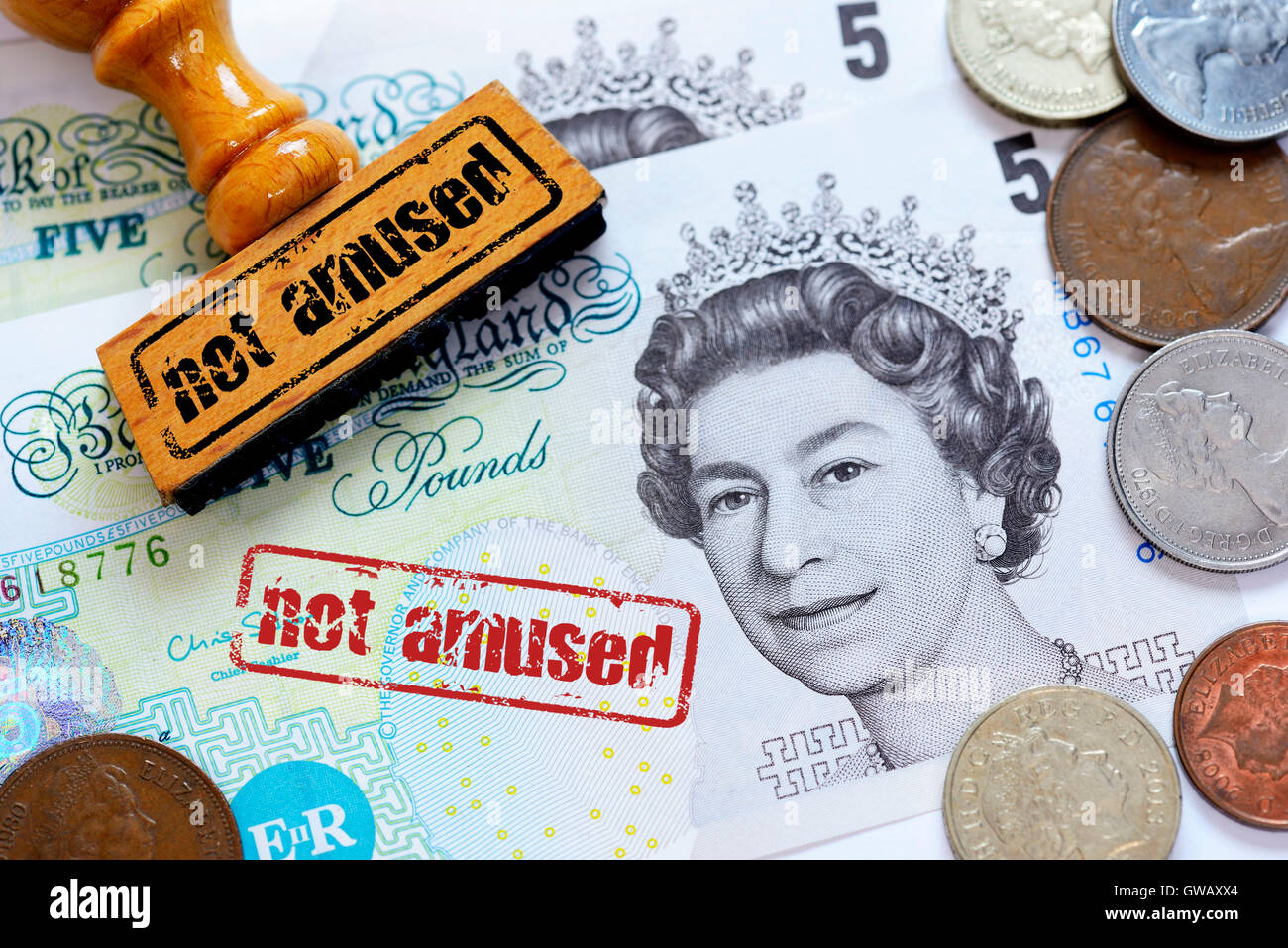 'British pound marks with stamp and label ''not amused'', symbolic photo Brexit', Britische - Stock Image