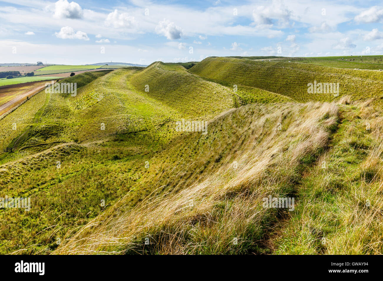 Ditches and ramparts on north side of Maiden Castle Stock Photo