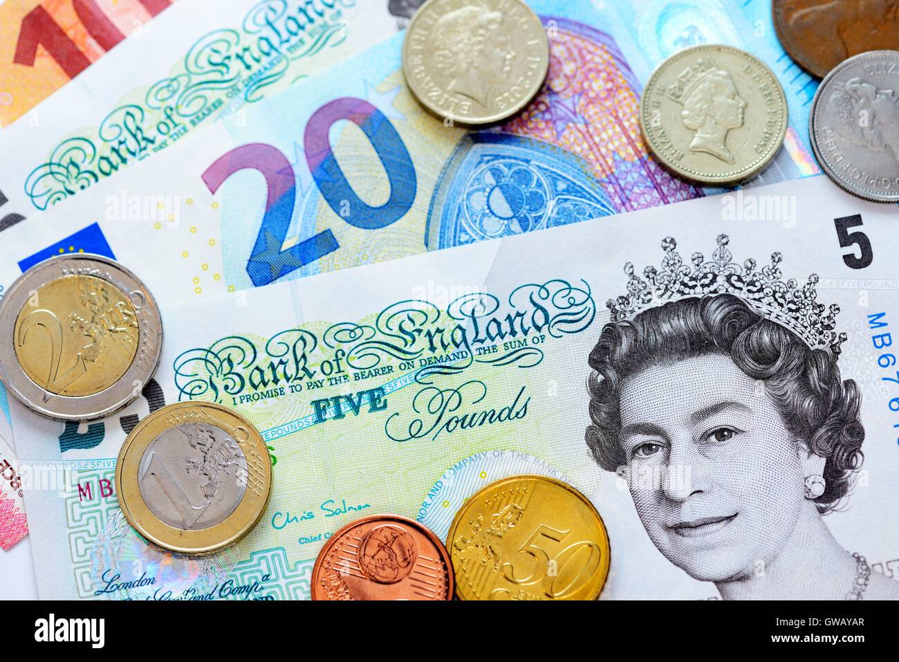 British pound marks and euro-bank notes and Euro monetary coins, Britische Pfundnoten und Euro-Geldscheine und  Stock Photo