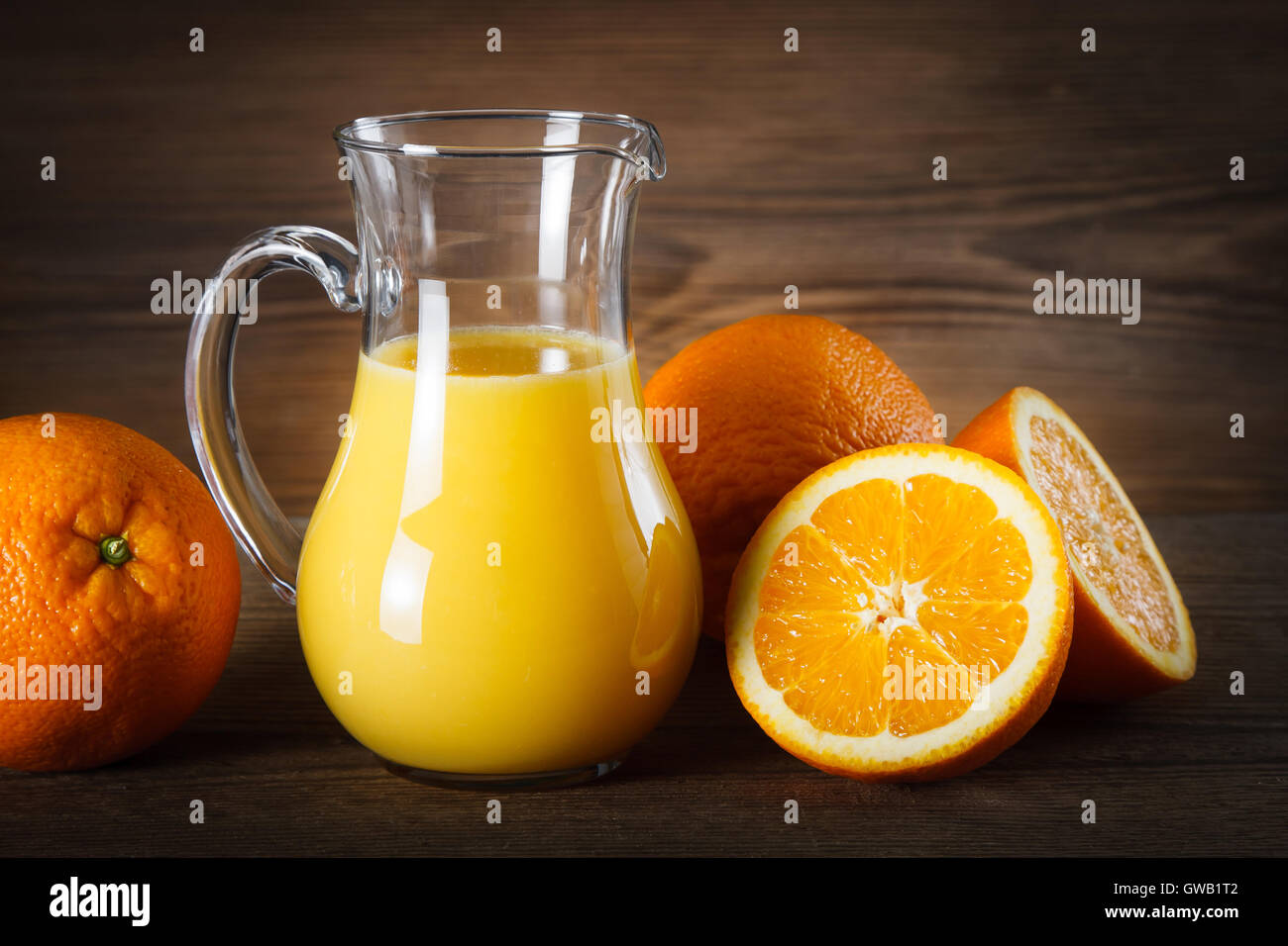 Fresh orange juice in glass pitcher - Stock Image