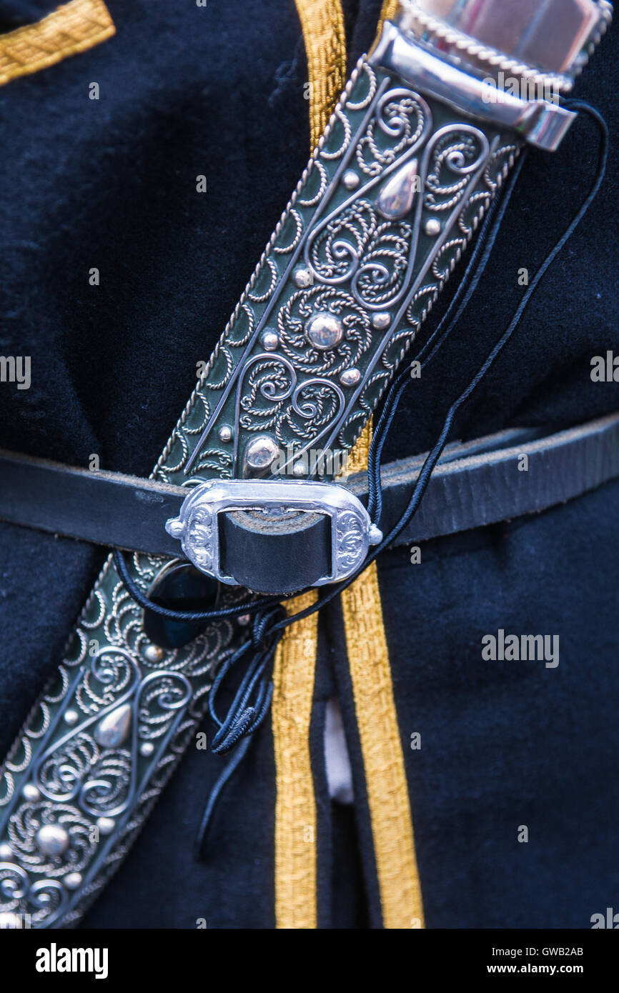 Details of a Caucasian traditional national male dress with a dagger - indispensable attribute of such a dress. - Stock Image