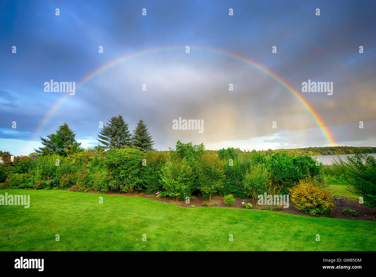 Rainbows about the big Poenitzer lake in Schleswig - Holstein, Germany, Europe, Regenbogen ueber dem Grossen Poenitzer - Stock Image