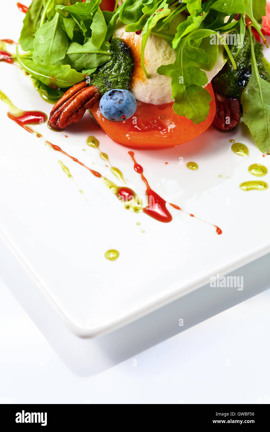 green salad with pesto sauce and berries - Stock Image