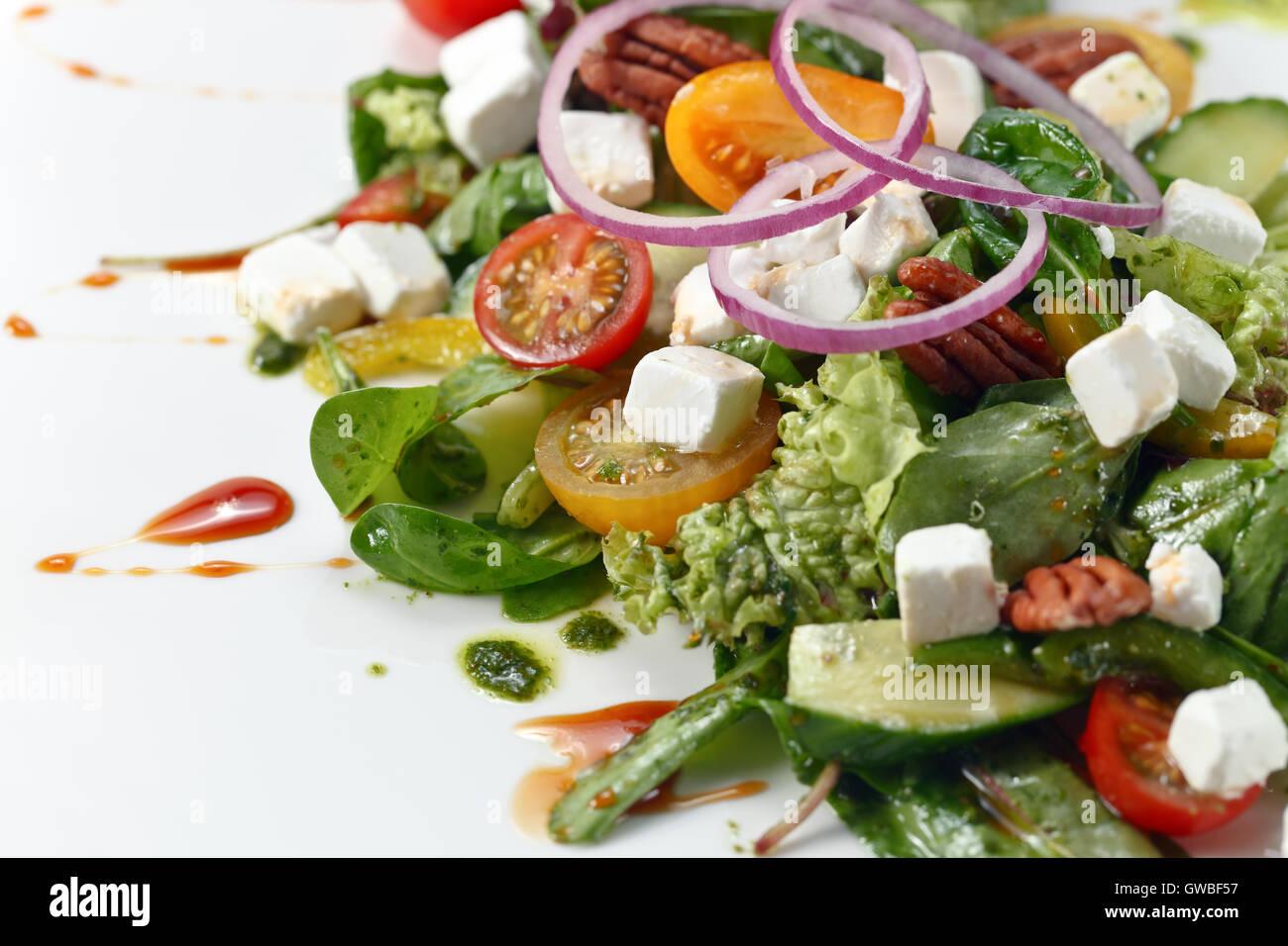 green salad with pesto sauce and mozzarella - Stock Image