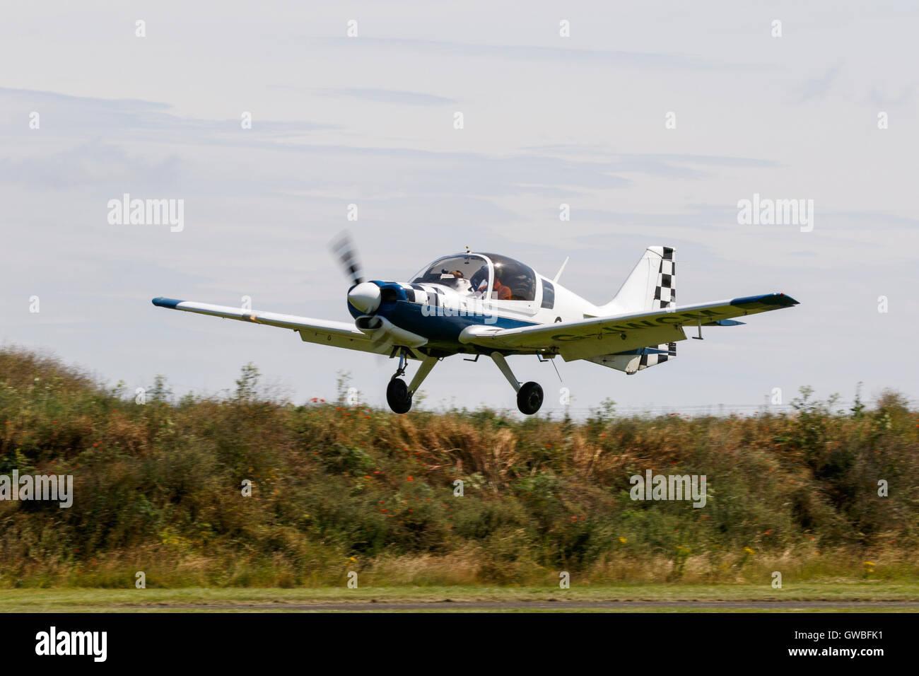 British Aerospace 120 Model 1210 Bulldog G-JWCM landing at Breighton Airfield - Stock Image