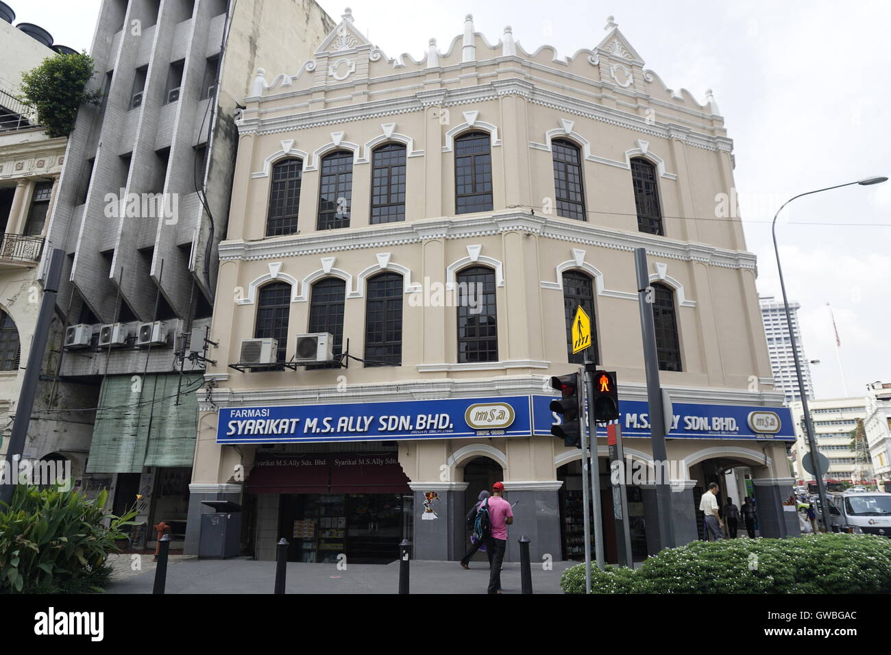 colonial shophouse building in downtown Kuala Lumpur and MS Ally , one of the oldest pharmacy in the city - Stock Image