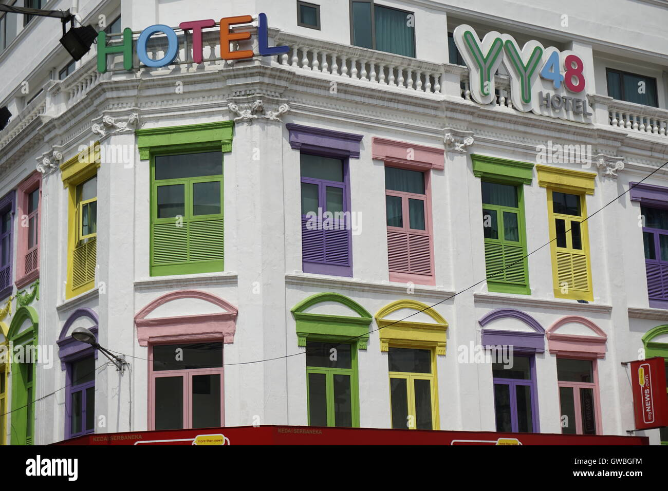 colonial shophouse building in downtown Kuala Lumpur with colorful window panes - Stock Image