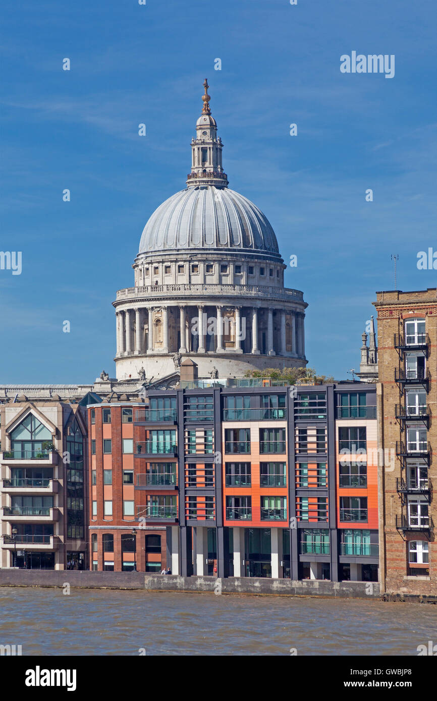 A view from Bankside of the dome of St Paul's Cathedral rising behind former Thames wharves - Stock Image