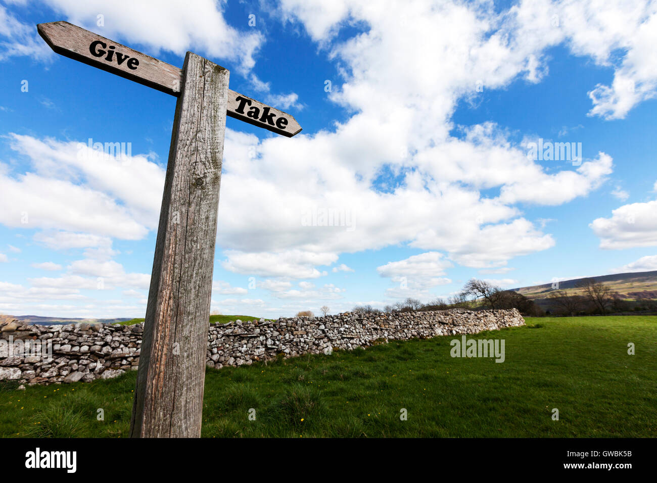 Give take sign words life signs fair fairness forgiveness motivation concept direction choice choose antonyms antonym - Stock Image