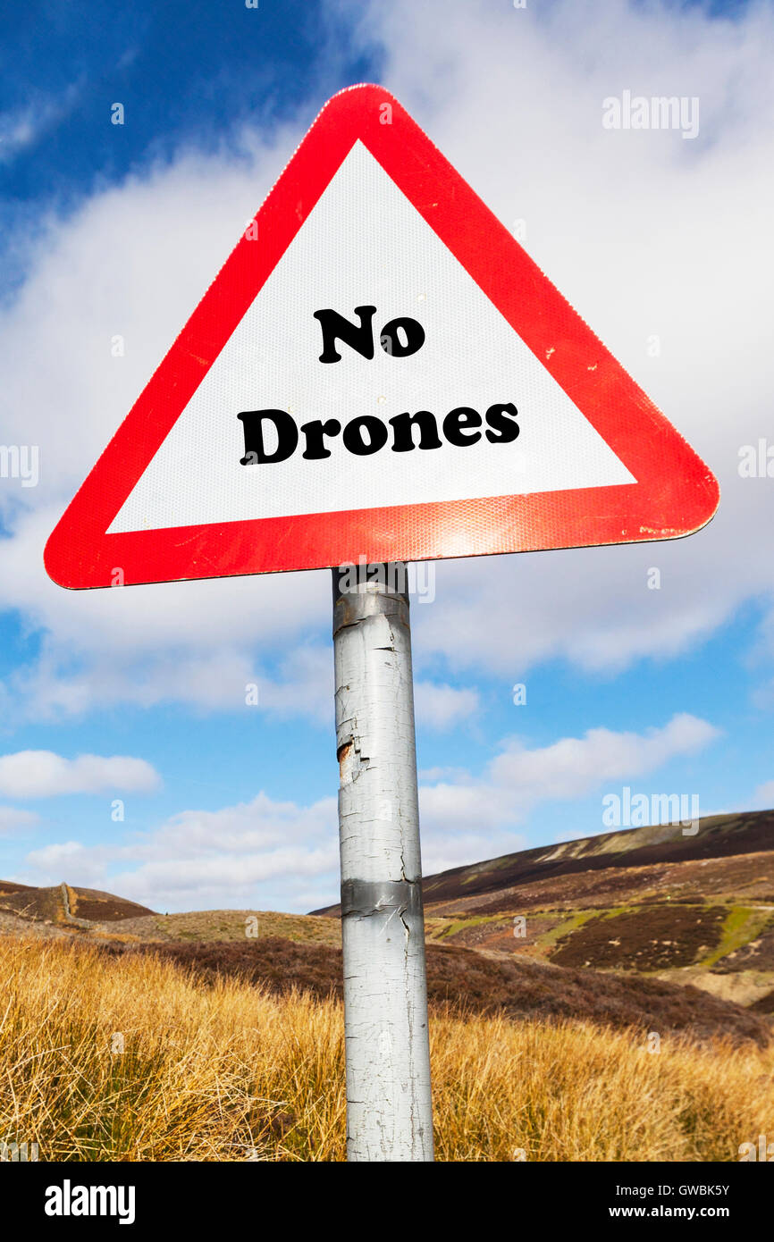 No Drones sign words written drone surveillance ban law violation control aircraft bans danger warning privacy security - Stock Image