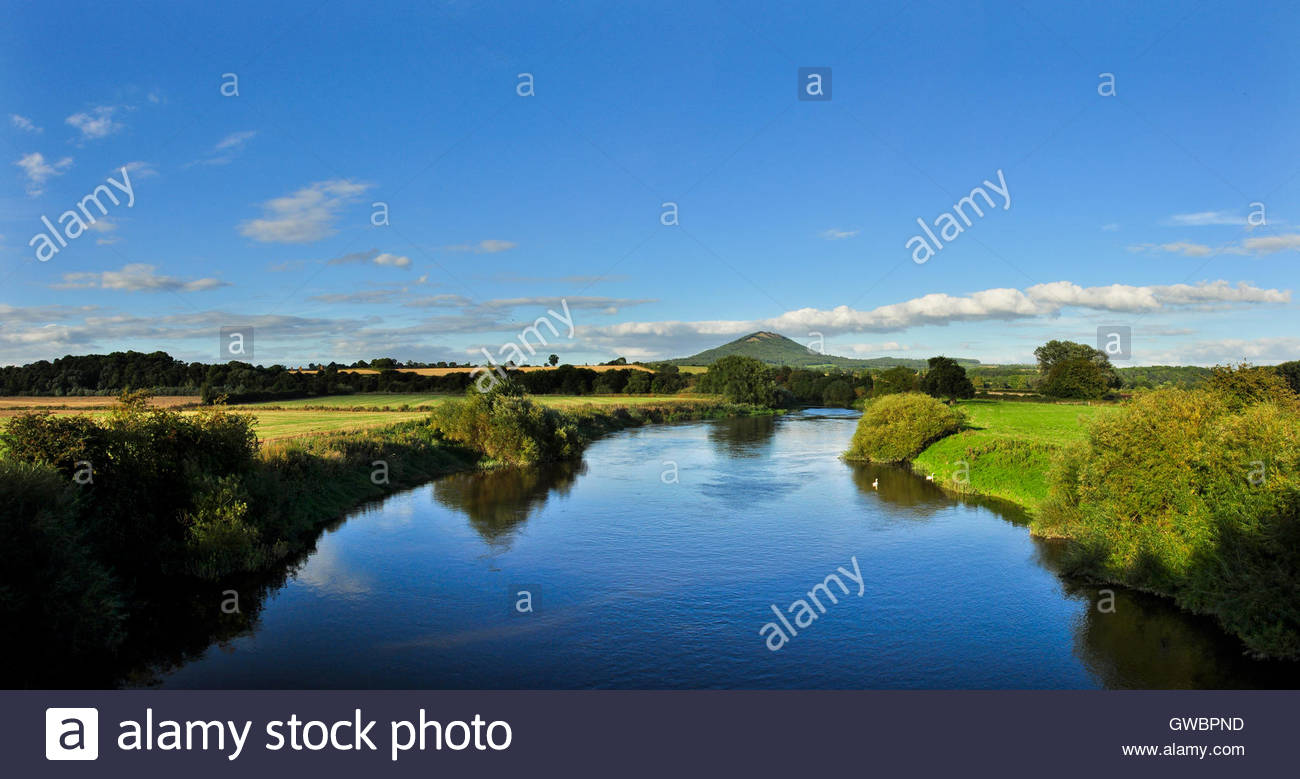 The River Severn with the Wrekin hill rising out of the Shropshire countryside viewed from Cressage, England, UK - Stock Image