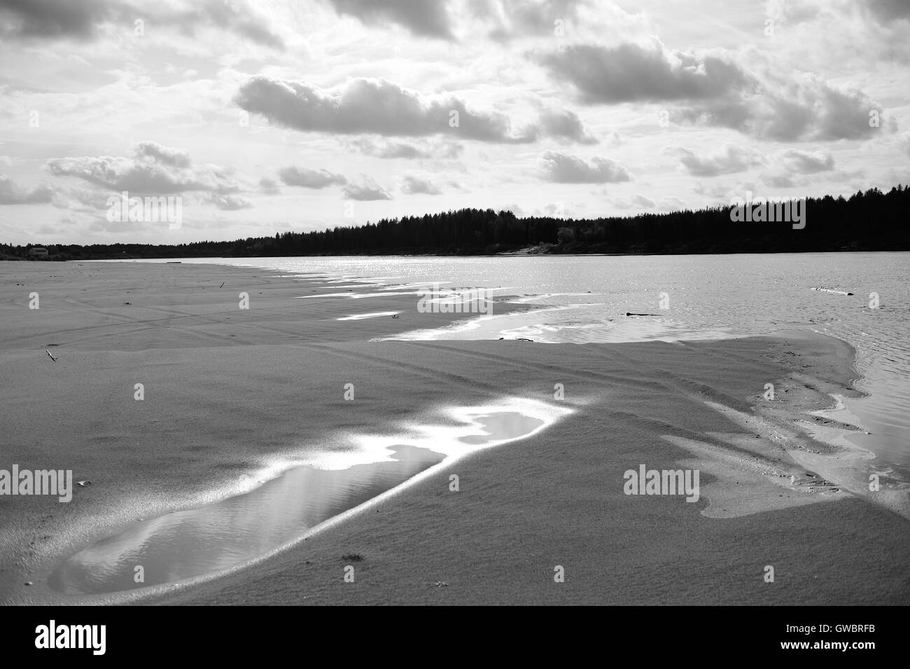 Landscape. River beach in black and white - Stock Image