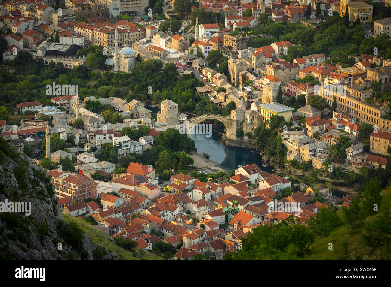 An aerial view of the Neretva river which runs across old Mostar and its Old Bridge (Stari Most). Bosnia Herzegovina Stock Photo