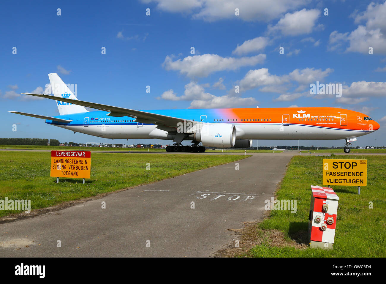 KLM Royal Dutch Airlines (Orange Pride) taxis to the gate at Amsterdam Schipol airport. - Stock Image