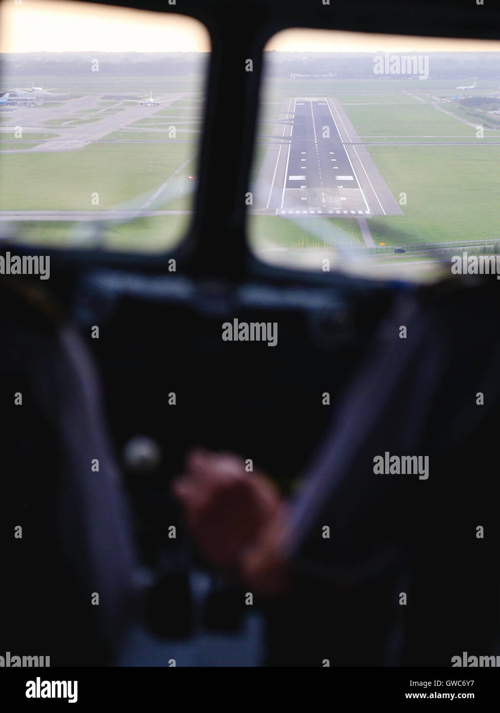 DDA Classic Flights approaches runway 27 at Amsterdam Schipol airport. - Stock Image