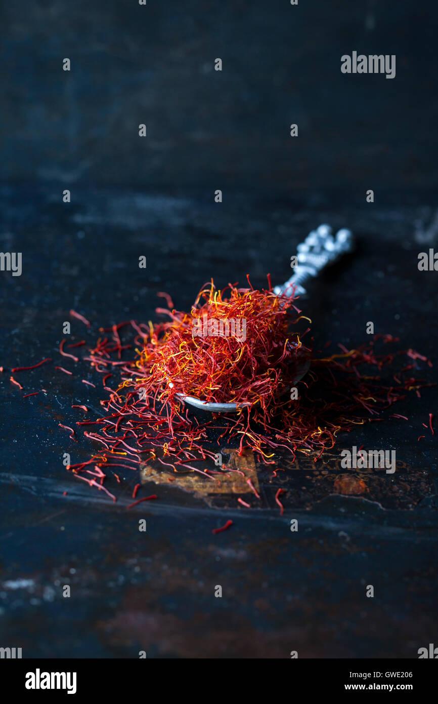 Saffron spice on the dark background - Stock Image