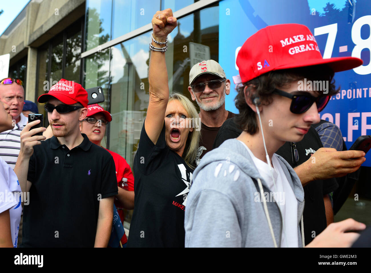 Donald Trump Rally in Asheville, NC, attracts angry protesters clashing with supporters on the sidewalks with signs - Stock Image