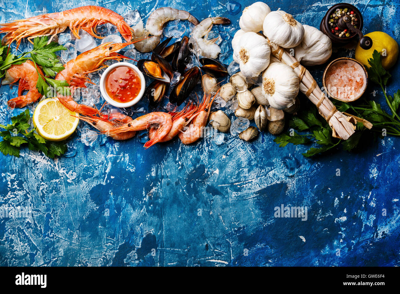 Seafood copy space Background with fresh raw Prawns, Clams, Mussels, Vongole, Shrimps and Ingredients - Stock Image