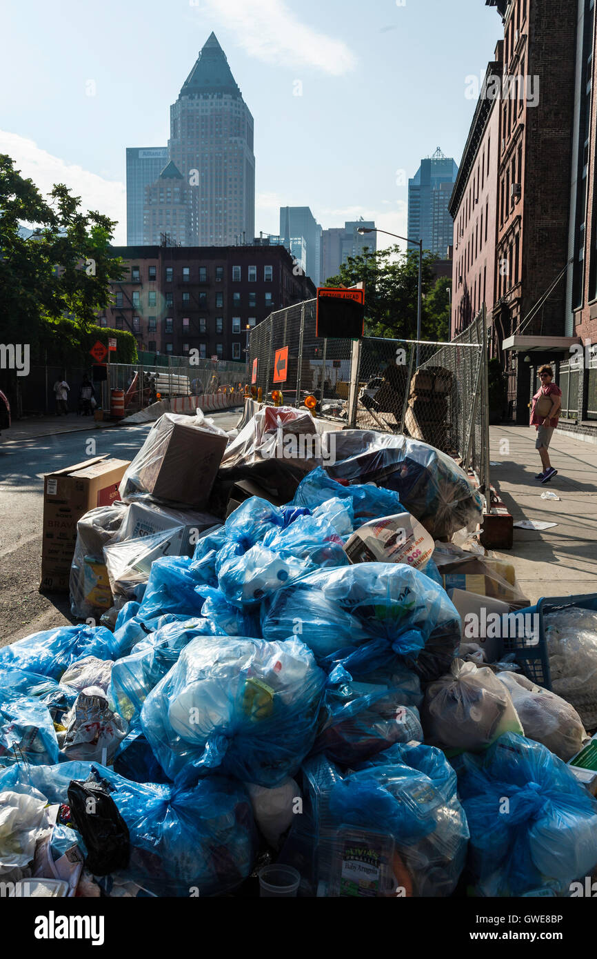 Piles of garbage in blue plastic bags waiting for collection from ...