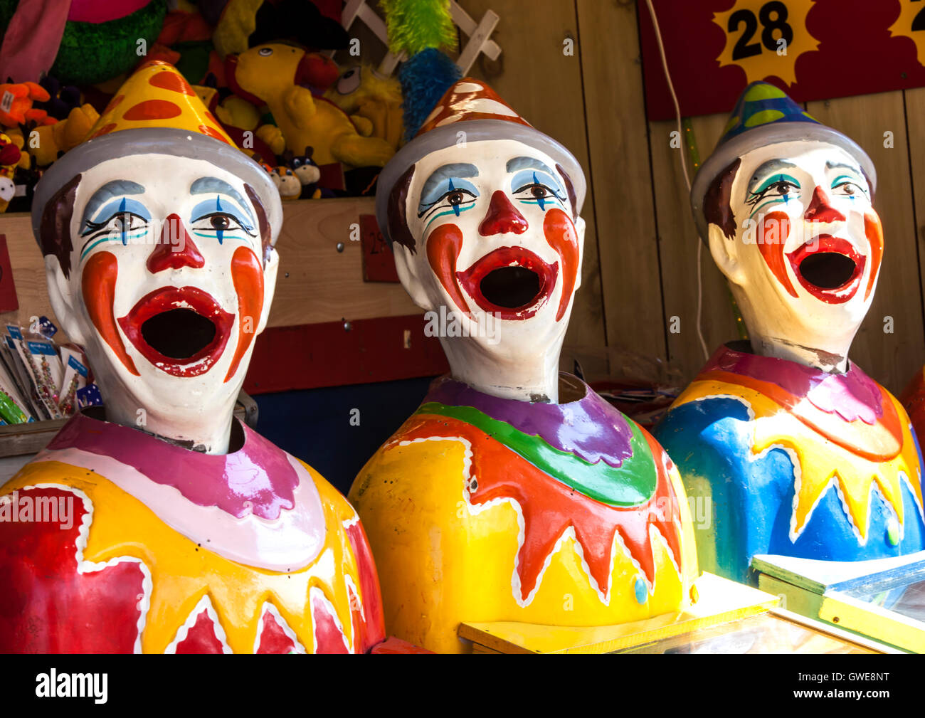 Fun fair clowns at side show alley Stock Photo