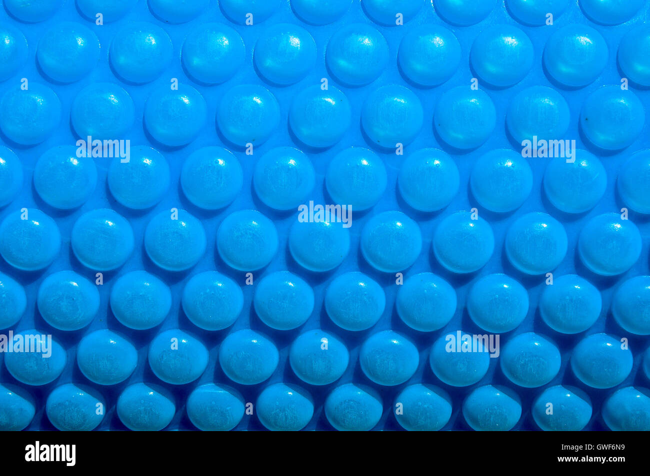 Abstract Closeup Of Bright Blue Bubble Pool Cover With