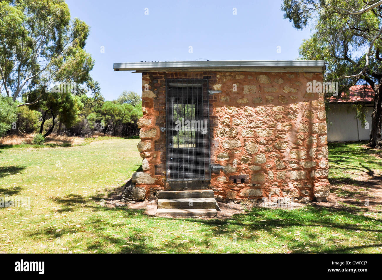 View through limestone brick outbuilding with metal screen on the Azelia Ley Homestead in Hamilton Hill,Western - Stock Image