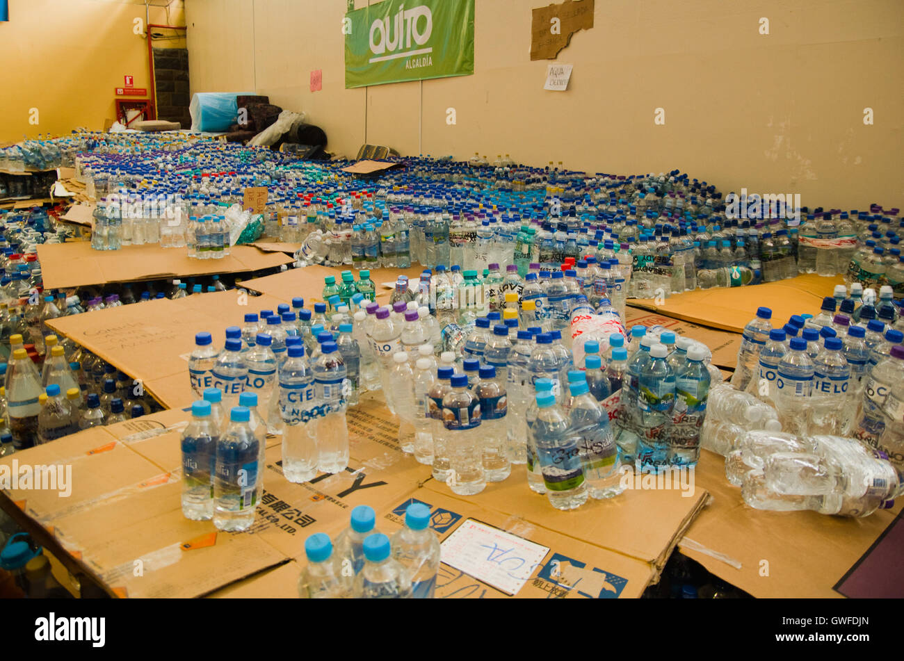 Quito, Ecuador - April 23, 2016: Water donated by citizens of Quito providing disaster relief for earthquake survivors - Stock Image