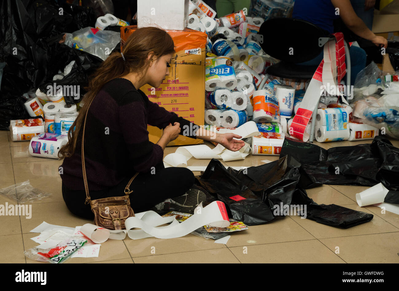 Quito, Ecuador - April 23, 2016: Unidentified citizens of Quito providing disaster relief food, clothes, medicine - Stock Image