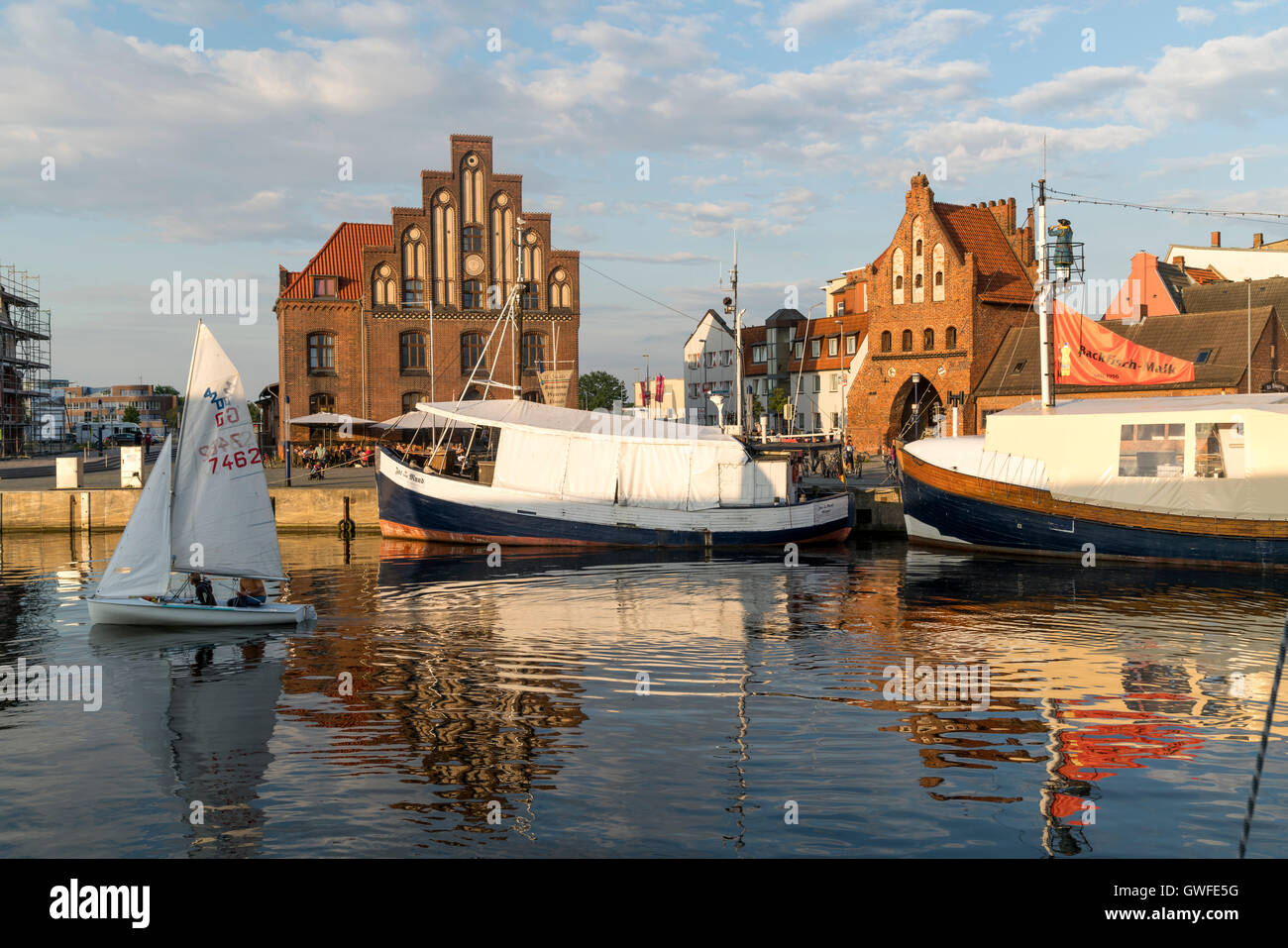 historic Old Harbour, watergate and old customs house, Hanseatic City of Wismar, Mecklenburg-Vorpommern, Germany - Stock Image