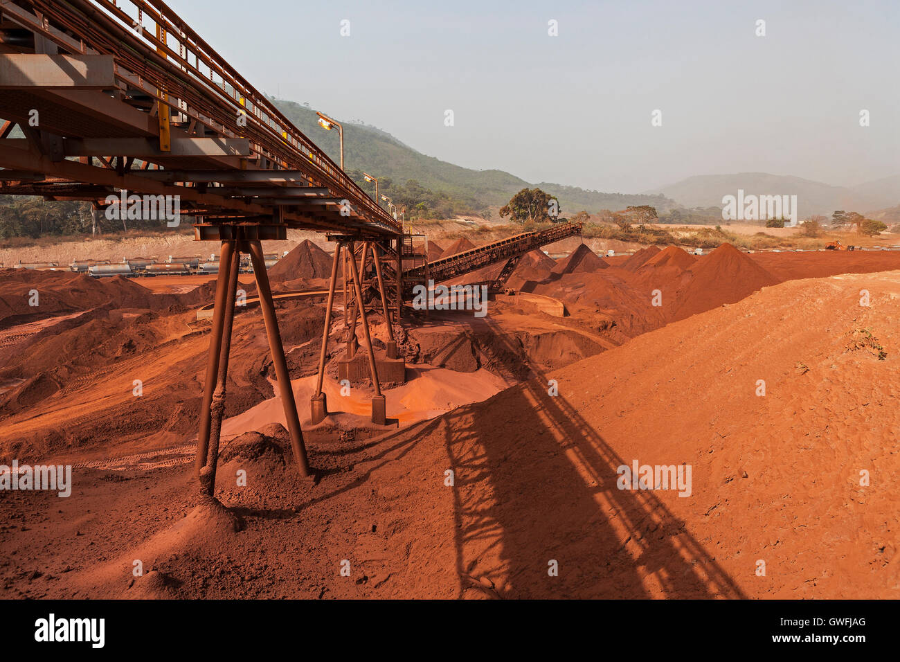 Mining operations for transporting and managing iron ore. Besides conveyor and above fines stacker towards stock - Stock Image