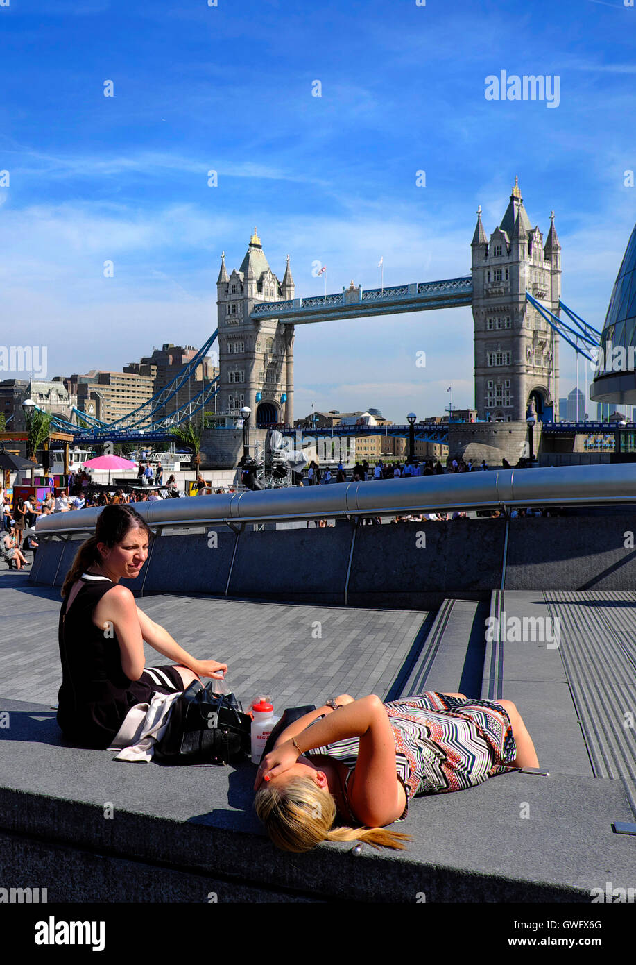 London, UK. 13th September, 2016. UK Weather:. Office workers bask in the 30 degree heat during their lunch hour - Stock Image