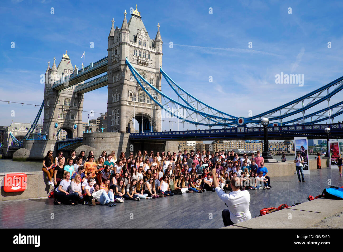 London, UK. 13th September, 2016. UK Weather: A tour group have their photo taken in front of Tower Bridge as London - Stock Image