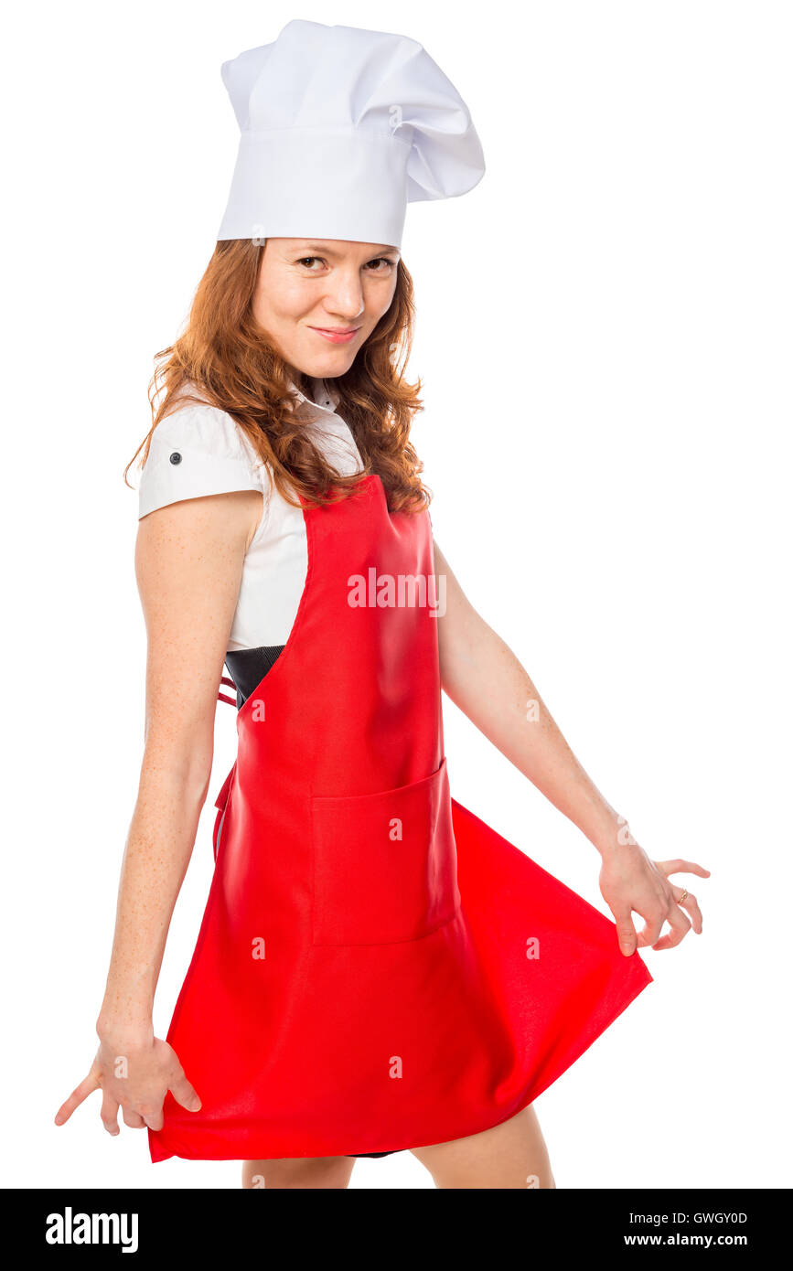 chef showing his red apron, portrait on a white background - Stock Image