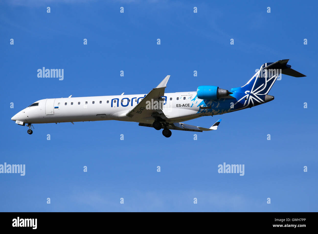 Nordica Bombardier CRJ-900 approaches runway 18C at Amsterdam Schipol airport. - Stock Image