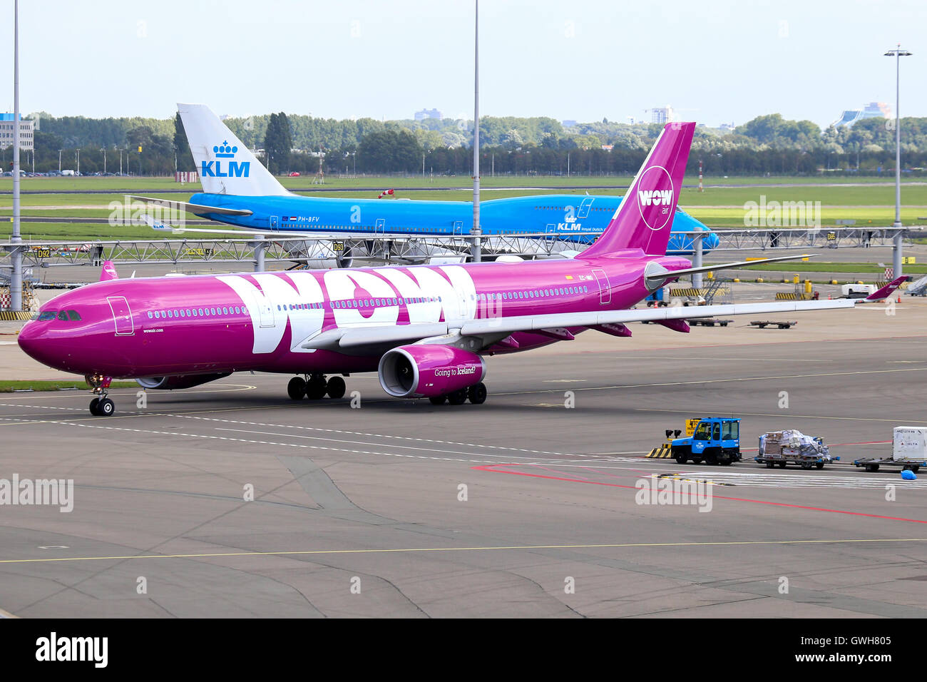 WOW Air Airbus A330-300 taxis for departure at Amsterdam Schipol airport. - Stock Image