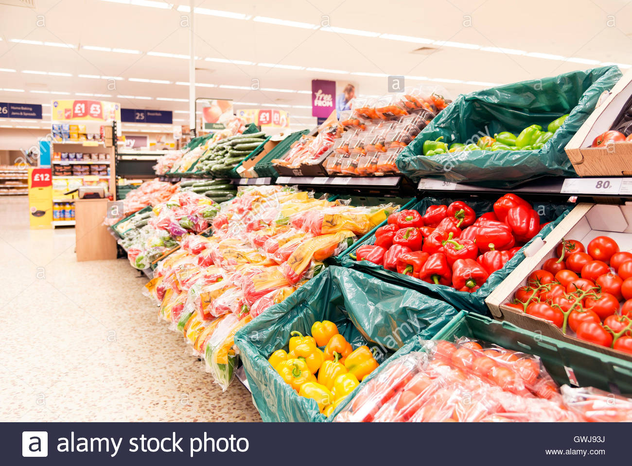 Bell peppers for sale in a supermarket, UK. - Stock Image