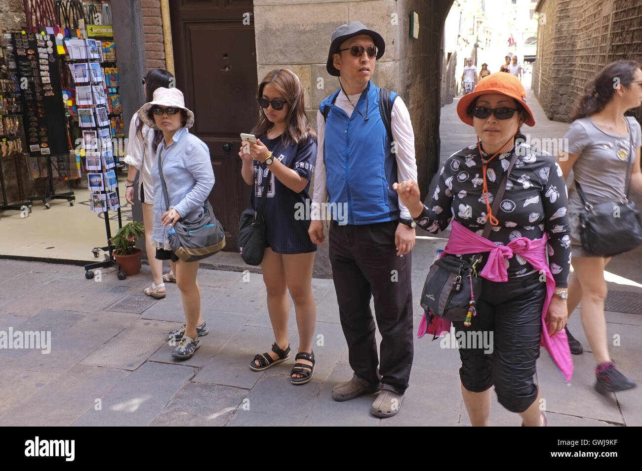Japanese tourists in Barcelona's medieval quarter - Stock Image