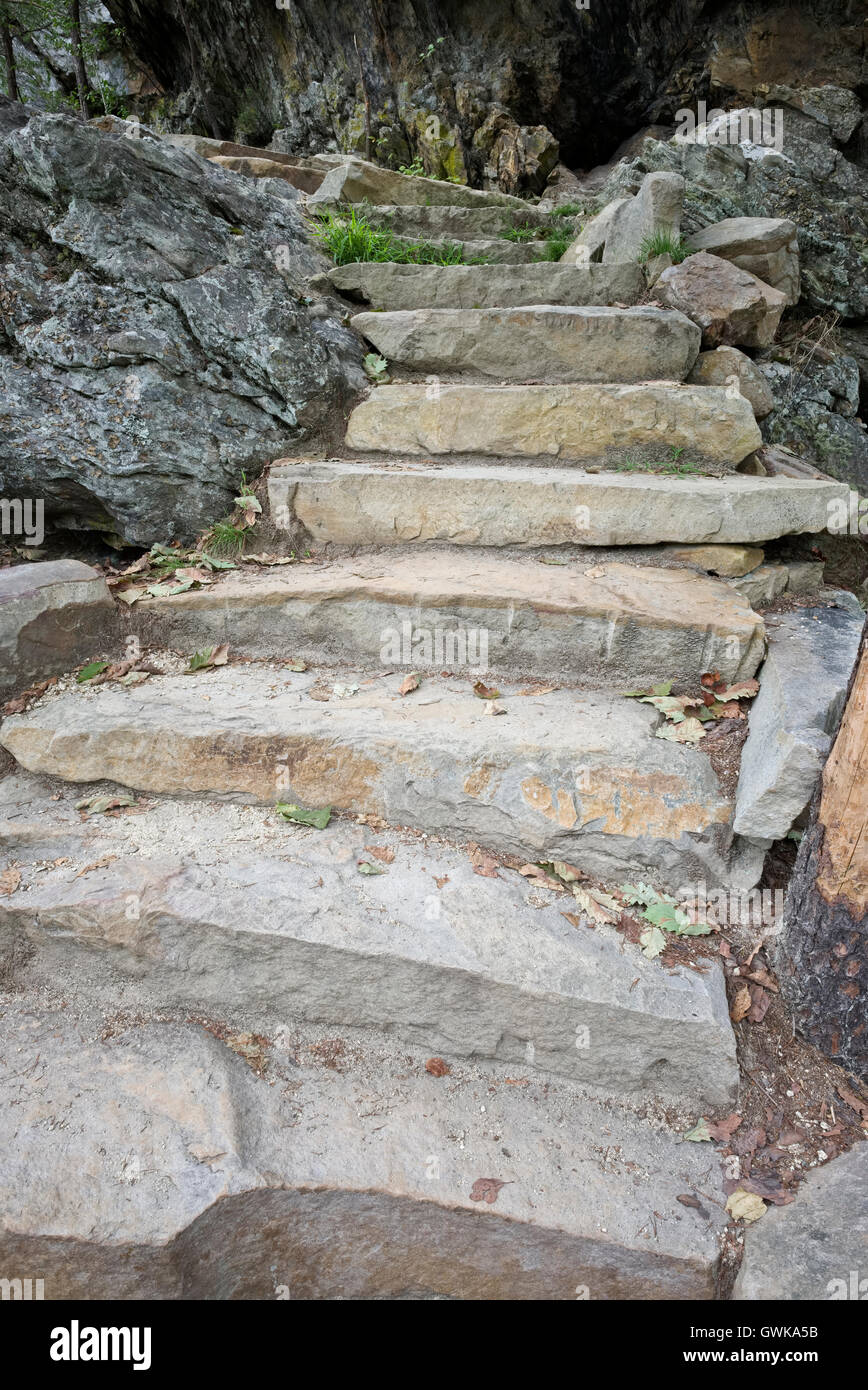 Stone / rock stairway steps. These rock stairs are at the Lower Cascades Falls in Hanging Rock State Park, NC - Stock Image