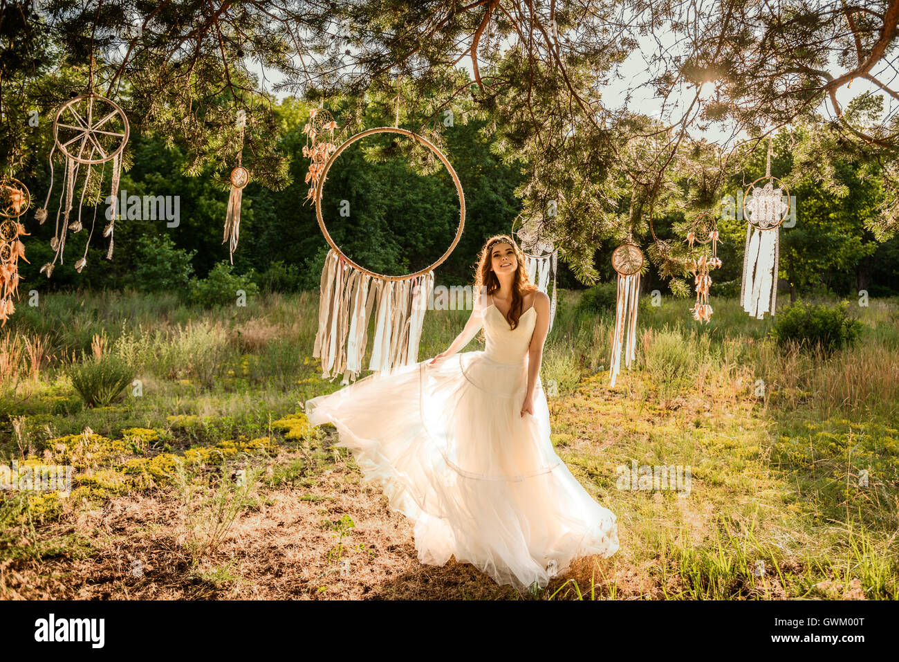young redheaded girl smiling, Girl in the forest, beautiful redheaded young girl, Girl near dreamcatcher - Stock Image