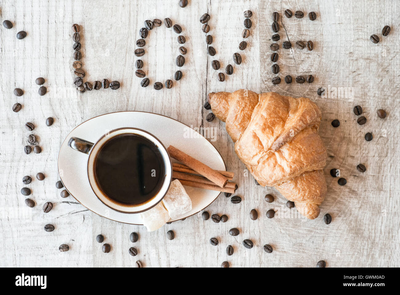 Cup of coffee with grains, croissant. title i love coffee. - Stock Image