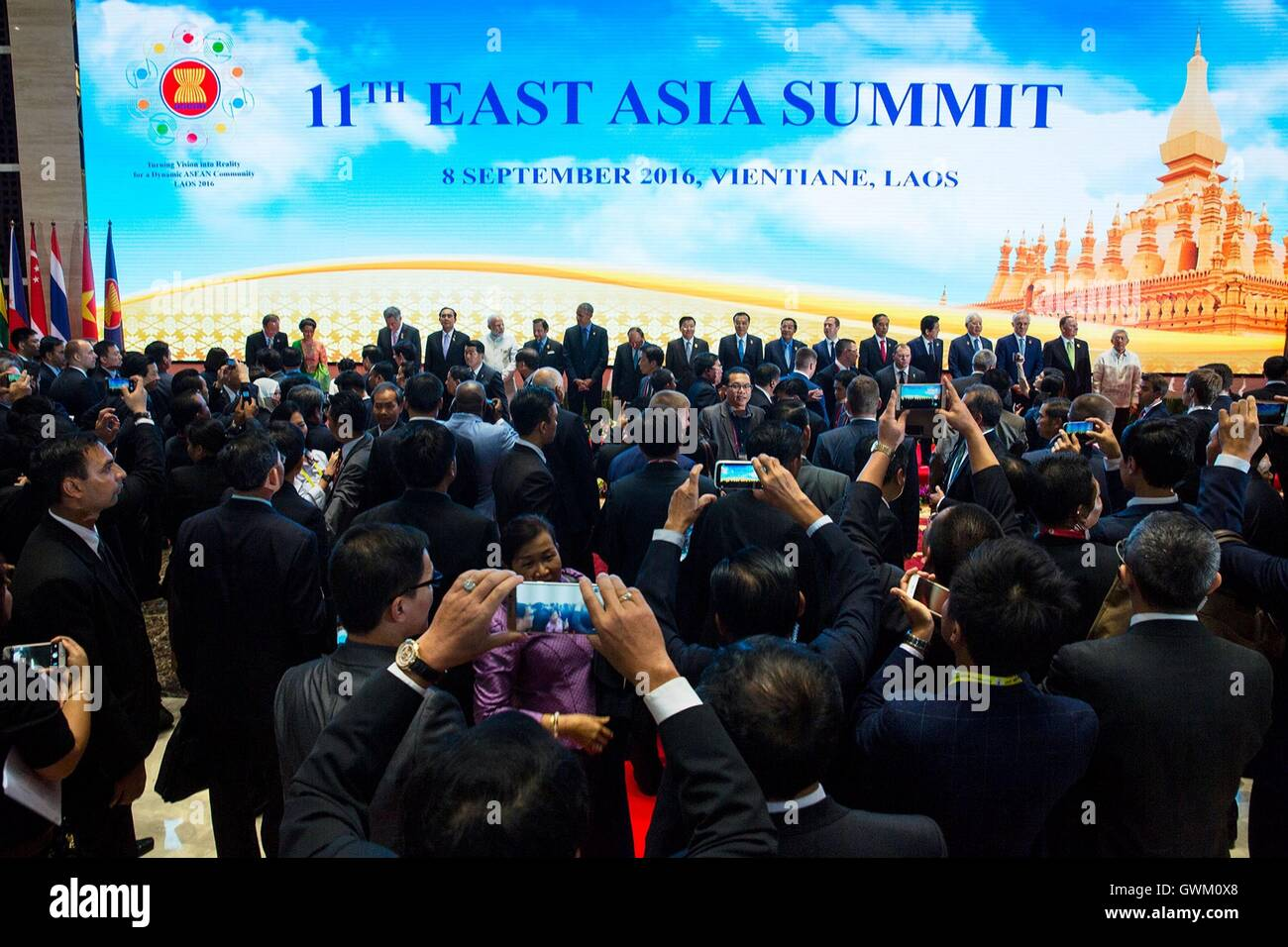 U.S. President Barack Obama joins East Asia Summit leaders for a group photo at the National Convention Center September - Stock Image