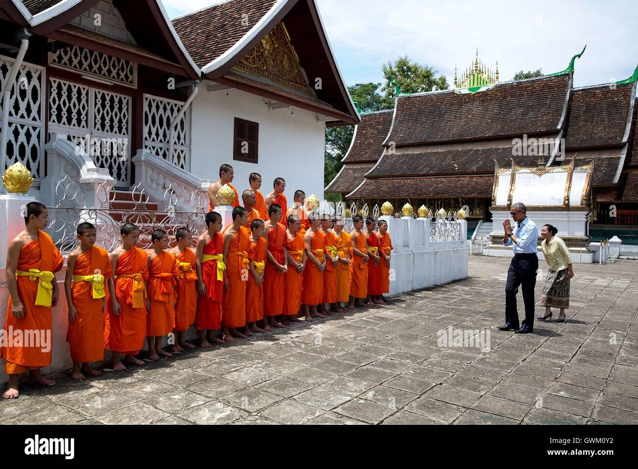 U.S President Barack Obama greets temple monks with a nop at the Wat Xiang Thong Buddhist temple September 2016 - Stock Image