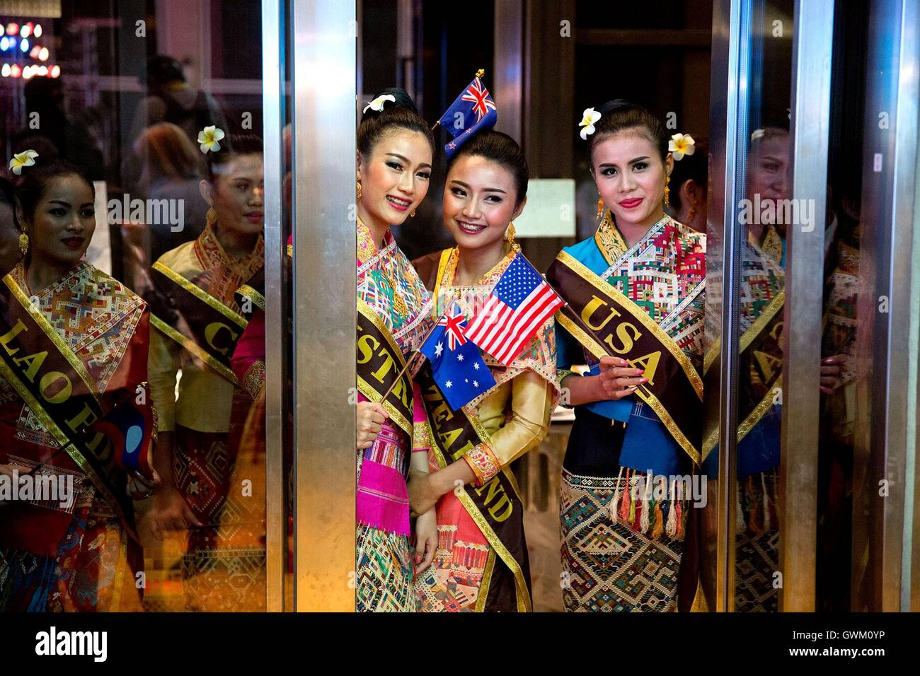 Hostesses wait to escort leaders to their seats before the Association of  Southeast Asian Nations gala
