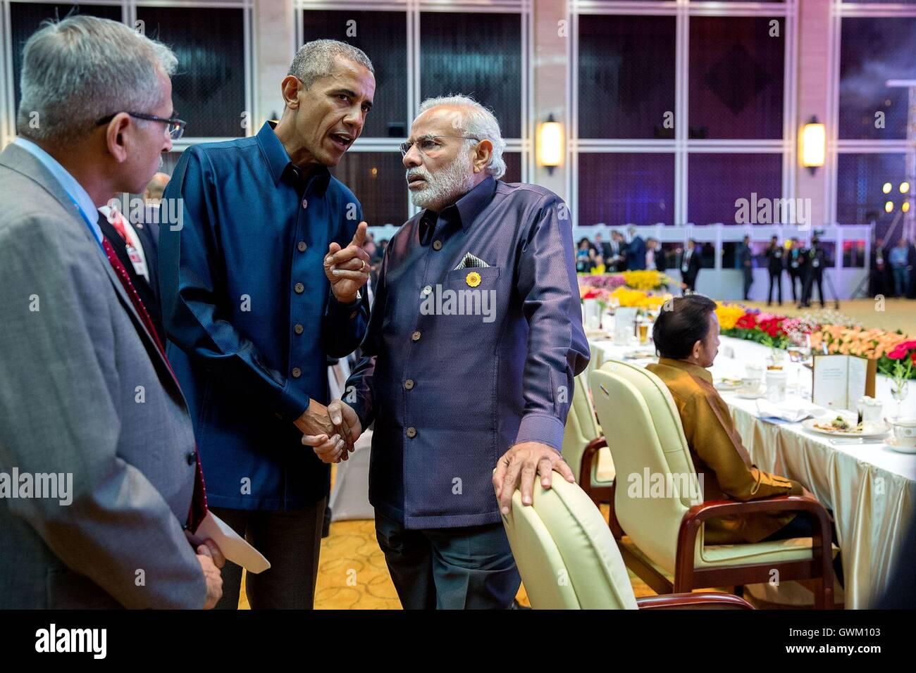 U.S. President Barack Obama talks with Prime Minister of India Narendra Modi during the ASEAN gala dinner at the - Stock Image